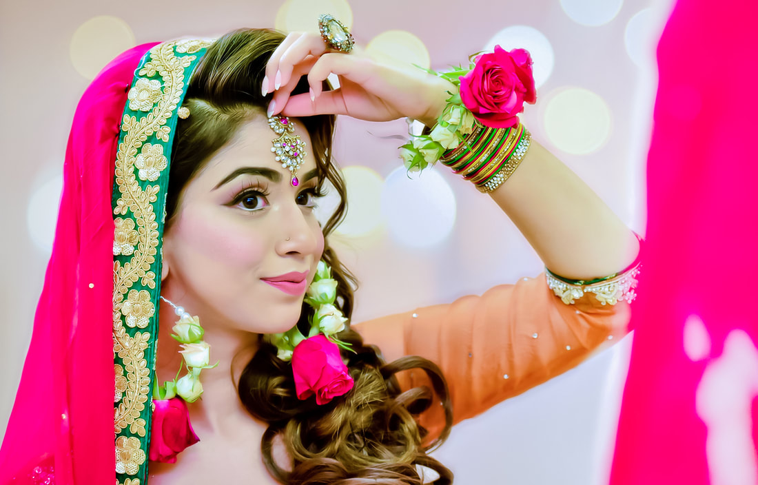 British Pakistani Bride Getting ready shots at her Mehndi
