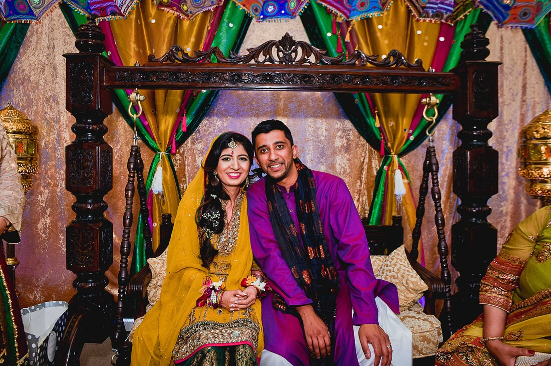 couple at their Mehndi jhoola nice decor